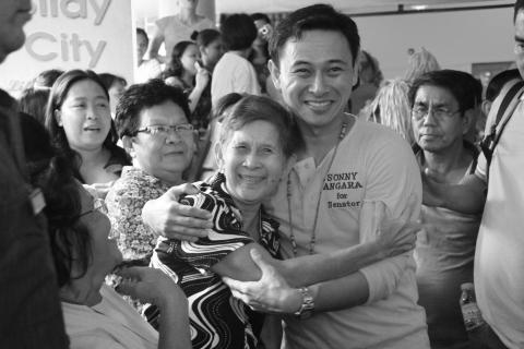 Senator Sonny Angara with a senior citizen